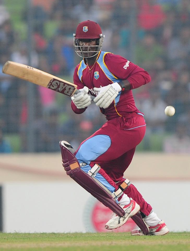 West Indies cricket captain Darren Sammy plays a shot during the fourth one day international cricket match between Bangladesh and the West Indies  at the Sher-e-Bangla National Cricket Stadium in Dhaka on December 7, 2012. AFP PHOTO/ Munir uz ZAMAN