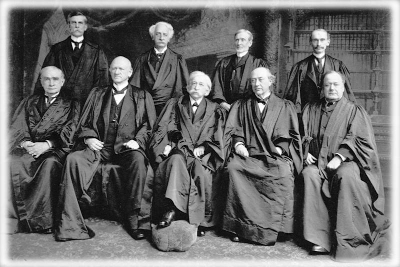1904: Members of the US Supreme Court Justice Oliver Wendell Holmes (1841 - 1935), Justice Peckham, Joseph McKenna (1843 - 1926), William Rufus Day (1849 - 1923), Henry Billings Brown (1836 - 1913), John Marshall Harlan (1833 - 1911), Melville Weston Fuller (1833 - 1910), David Josiah Brewer (1837 - 1910) and Edward Douglass White (1845 - 1921). (Photo: MPI/Getty Images, digitally enhanced by Yahoo News)