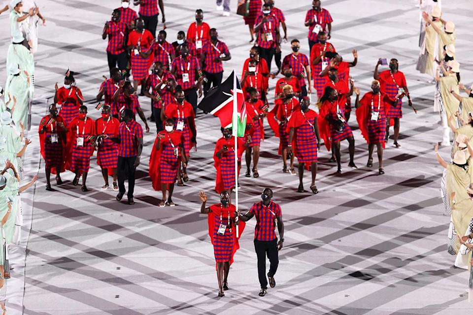 <p>Kenya donned striking blue and red plaid ensembles with red capes to the opening ceremony. </p>