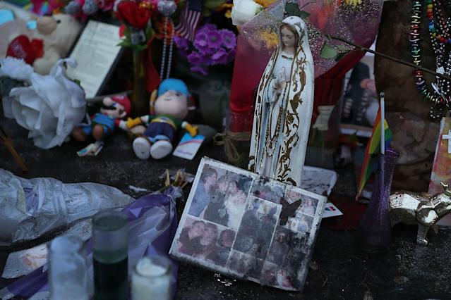 <p>Personnel items are seen in a memorial to the victims of the mass shooting setup around the Pulse gay nightclub one day before the one year anniversary of the shooting on June 11, 2017 in Orlando, Florida. (Joe Raedle/Getty Images) </p>