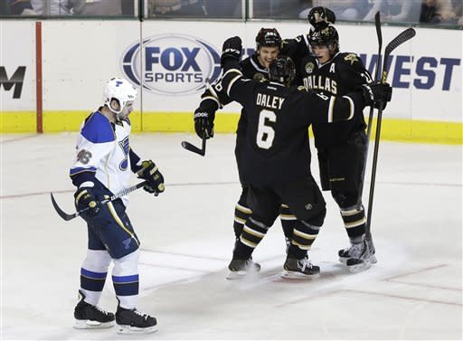 St. Louis Blues' Roman Polak (46) of Czech Republic skates back to the bench as Dallas Stars' Trevor Daley (6), Jordie Benn, left, rear, and Loui Eriksson, right rear, celebrate a goal by Eriksson in the third period of an NHL hockey game Sunday, March 3, 2013, in Dallas. The Stars won 4-1. (AP Photo/Tony Gutierrez)