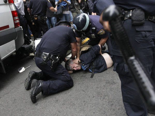 The city settled with Ari Douglas, who was struck by a NYPD scooter during a protest, after a seven year legal battle.