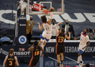 New Orleans Pelicans center Jaxson Hayes (10) dunks past Atlanta Hawks guard Bogdan Bogdanovic (13) and forward Solomon Hill (18) in the first quarter of an NBA basketball game in New Orleans, Friday, April 2, 2021. (AP Photo/Derick Hingle)