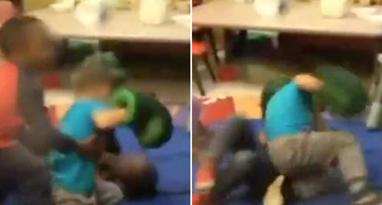 A boy tries in vain to intervene as one boy punches another one on the floor. (Source: KTVI)