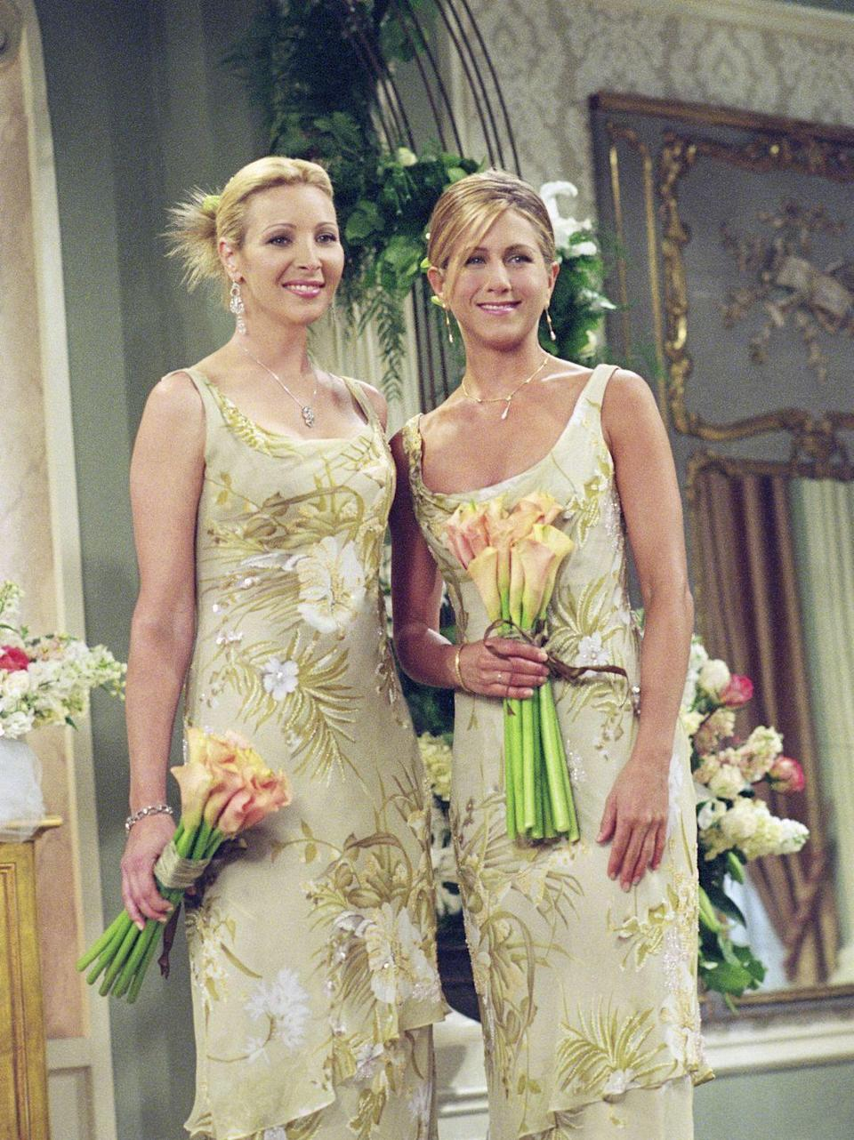 <p>Not only did Phoebe and Rachel look great as bridesmaids on <em>Friends</em>, but their sleeveless floral gowns are totally on trend for the moment. </p>
