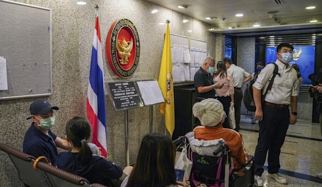 People wait at the Royal Thai Consulate-General in Central. Photo: Sam Tsang