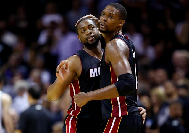 FILE - JUNE 28, 2014: It was reported that both Dwyane Wade and Chris Bosh are opting out of their contracts with the Miami Heat in order to be free agents June 28, 2014. SAN ANTONIO, TX - JUNE 08: Chris Bosh #1 of the Miami Heat celebrates with Dwyane Wade #3 against the San Antonio Spurs during Game Two of the 2014 NBA Finals at the AT&T Center on June 8, 2014 in San Antonio, Texas. The Miami Heat defeated the San Antonio Spurs 98-96. (Photo by Andy Lyons/Getty Images)