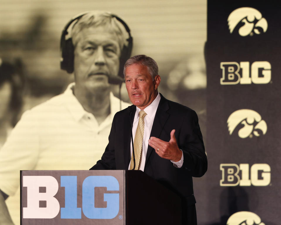 FILE - In this July 19, 2019, file photo, Iowa head coach Kirk Ferentz responds to a question during the Big Ten Conference NCAA college football media days in Chicago. Big Ten is going to give fall football a shot after all. Less than five weeks after pushing football and other fall sports to spring in the name of player safety during the pandemic, the conference changed course Wednesday, Sept. 16, 2020, and said it plans to begin its season the weekend of Oct. 23-24.(AP Photo/Charles Rex Arbogast, File)