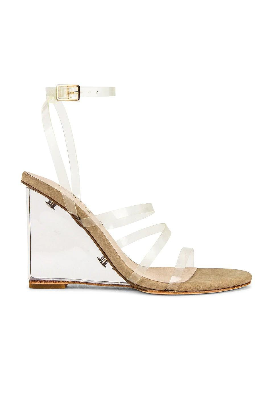<p>This <span>Raye Bev Wedge</span> ($178) goes with everything. The clear strap will keep your foot held in, which is great.</p>