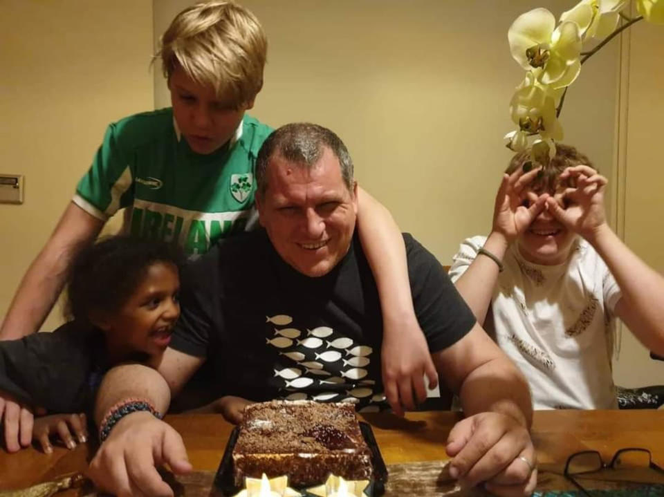 Irish engineer Robert Pether pictured with his three children and a cake. Source: Newsflash/Australscope