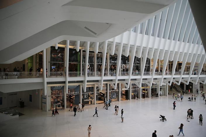 <p>People walk through the Oculus mall at World Trade Center on Monday, August 22, 2016. It stretches along a four-block underground network that spans the bases of three office towers. While mostly below street level, light beams in through the windows of the winged Oculus, designed by Santiago Calatrava, that top the transportation hub of 13 subway trains and river ferries. (Gordon Donovan/Yahoo News) </p>