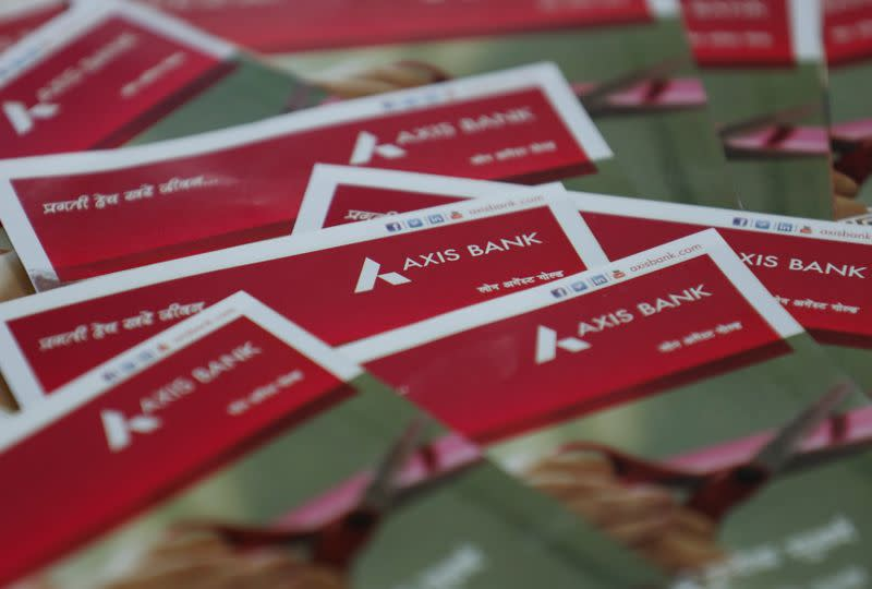 Brochures are seen at a branch of Axis Bank in Mumbai