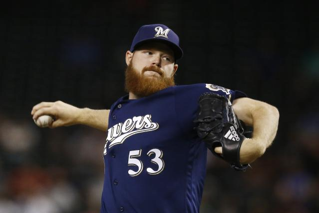 Milwaukee Brewers pitcher Brandon Woodruff throws against the Arizona Diamondbacks during the first inning of a baseball game Wednesday, May 16, 2018, in Phoenix. (AP Photo/Ross D. Franklin)