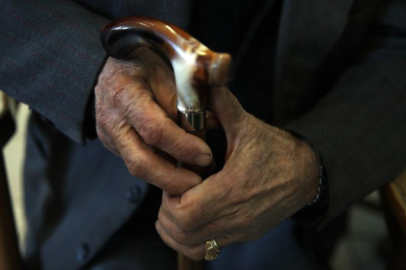 In this Tuesday, May 14, 2019, photo an elderly man holds his walking stick in Karpenisi town at Evrytania region, in central Greece. As balloting for the European Parliament gets underway Thursday and continues through Sunday, voters over 55 are emerging as a powerful bloc on a rapidly aging continent as younger voters stay away from the polls in growing numbers. (AP Photo/Thanassis Stavrakis)
