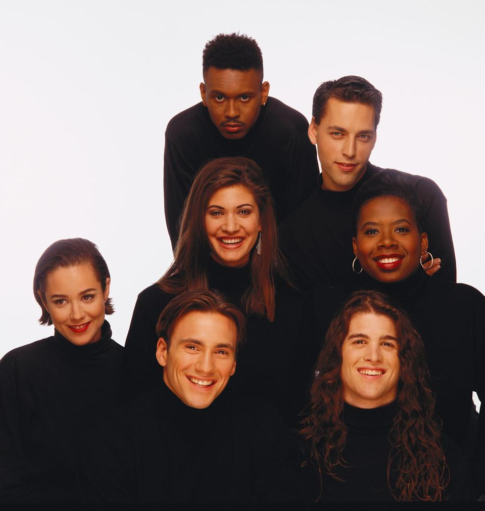 "The inaugural cast of 'The Real World' - Kevin Powell, top clockwise, Norman Korpi, Heather B. Gardner, Andre Comeau, Eric Nies, Beck Blasband and Julie Gentry, center, as seen in 1992, reunites in 'The Real World Homecoming: New York"" on Paramount+."