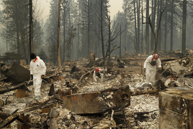 Search and rescue workers search for human remains at a trailer park burned in the Camp fire on Nov. 13, 2018, in Paradise, California. (ASSOCIATED PRESS)