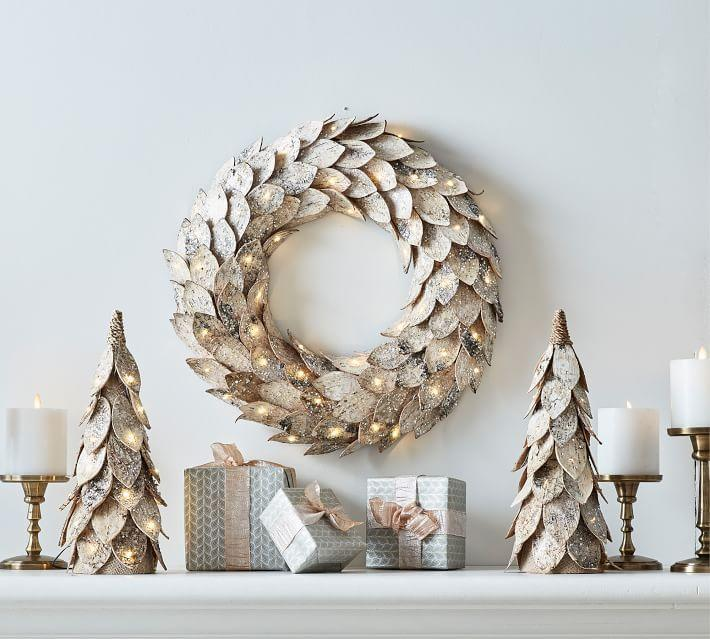 "<p><strong>Pottery Barn</strong></p><p>potterybarn.com</p><p><strong>$149.00</strong></p><p><a href=""https://go.redirectingat.com?id=74968X1596630&url=https%3A%2F%2Fwww.potterybarn.com%2Fproducts%2Flit-birch-wreath%2F&sref=https%3A%2F%2Fwww.elledecor.com%2Fdesign-decorate%2Fg2825%2Fbest-christmas-wreaths%2F"" rel=""nofollow noopener"" target=""_blank"" data-ylk=""slk:Shop Now"" class=""link rapid-noclick-resp"">Shop Now</a></p><p>The natural birch bark brings out the warm, wintry shades of nature, while the lights provide a welcoming glow.</p>"