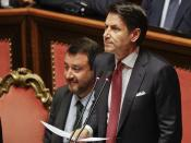 FILE - In this Tuesday, Aug. 20, 2019 file photo, Italian Premier Giuseppe Conte, right, is flanked by Deputy-Premier Matteo Salvini as he addresses the Senate in Rome. When Giuseppe Conte exited the premier's office, palace employees warmly applauded in him appreciation. But that's hardly likely to be Conte's last hurrah in politics. Just a few hours after the handover-ceremony to transfer power to Mario Draghi, the former European Central Bank chief now tasked with leading Italy in the pandemic, Conte dashed off a thank-you note to citizens that sounded more like an ''arrivederci″ (see you again) then a retreat from the political world he was unexpectedly propelled into in 2018.(AP Photo/Gregorio Borgia, File)