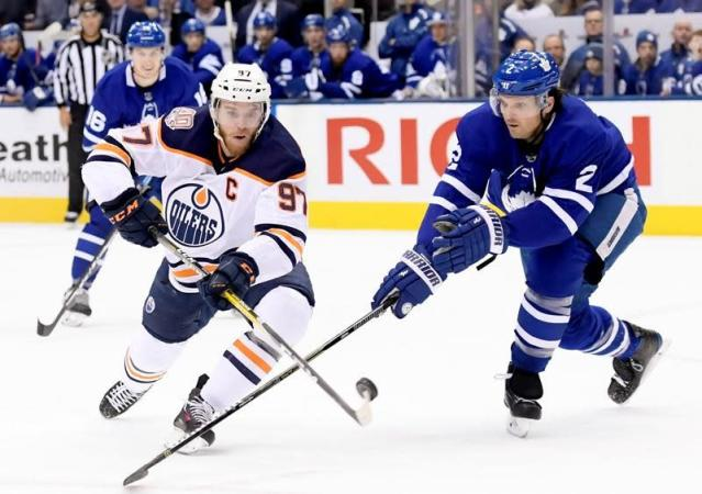 """OTTAWA — Pierre Dorion added the veteran leadership he was looking for on the opening day of free agency.The Ottawa Senators general manager signed veteran defenceman Ron Hainsey to a one-year deal worth US$3.5 million, as well as forward Tyler Ennis to a one-year, $800,000 contract on Monday.Both players spent last season with Toronto, allowing for a reunion with new Ottawa head coach and former Leafs assistant D.J. Smith.""""When you have a guy who's had them in the room for the past two years, I think it's just a bonus,"""" Dorion said.""""He knows their character. He knows he doesn't want bad apples in the room and if you talk to D.J. and I'm sure you will at some point in time in the summer he's going to vouch for the character of these four players and for us that's just a bonus in the culture that we're trying to achieve here.""""Hainsey and Ennis aren't the only players switching sides in the Battle of Ontario.Earlier Monday, the Senators acquired defenceman Nikita Zaitsev and forwards Connor Brown and Michael Carcone from the Leafs in exchange for defencemen Cody Ceci and Ben Harpur, forward Aaron Luchuk and a 2020 third-round draft pick. .""""With his 1,068 career NHL games under his belt, Hainsey has, by far, the most experience on the Senators' young blue line. He is expected to help with the development of young defenceman such as Thomas Chabot, Christian Wolanin and Christian Jaros.""""We were looking for someone as a mentor,"""" said Dorion. """"Someone that could stabilize our young defence. I think Ron will help in the day-to-day. He's been around it all, he's been a (Stanley) Cup winner, he's done it all.""""He's a veteran presence and he'll bring a calming effect and I think you'll see us less running around because of the presence Ron Hainsey brings.""""Last season, Hainsey, 38, had five goals and 18 assists in 81 games. He added one assist in seven playoff games.Despite the addition of Hainsey and Zaitsev, Dorion says young defencemen will still be given an opportunity to fi"""