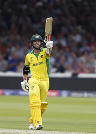 Australia's David Warner celebrates after getting 50 runs not out during their Cricket World Cup match between England and Australia at Lord's cricket ground in London, Tuesday, June 25, 2019. (AP Photo/Alastair Grant)