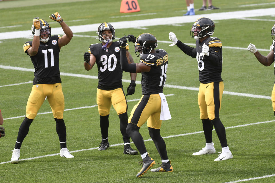 Pittsburgh Steelers wide receiver JuJu Smith-Schuster (19) dances with teammates in the end zone after catching a pass against the Houston Texans and running it in for a touchdown in the first half of an NFL football game, Sunday, Sept. 27, 2020, in Pittsburgh. (AP Photo/Don Wright)