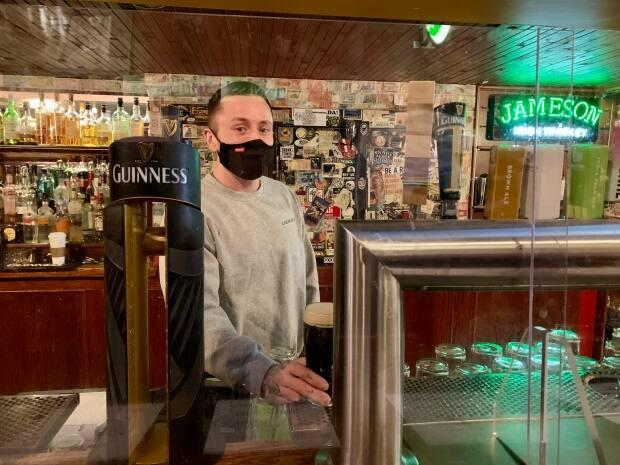 Andrew Shanks, the general manager at O'Hanlon's Irish Pub in Regina, said he and his staff are just 'celebrating being open' this year on St. Patrick's Day, after voluntarily closing last year at the start of the pandemic.