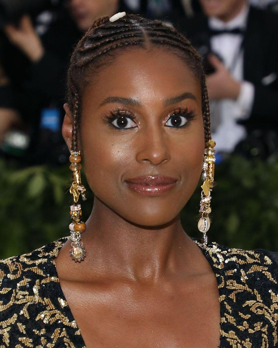 """<p>Actress <strong>Issa Rae</strong>'s <a href=""""https://www.goodhousekeeping.com/beauty/hair/g27542026/updos-for-short-hair/"""" rel=""""nofollow noopener"""" target=""""_blank"""" data-ylk=""""slk:glam hairstyle"""" class=""""link rapid-noclick-resp"""">glam hairstyle</a> has an extra touch of sparkle with gold embellishments. With or without the decorative beads, this Fulani braids look is both regal and fun. </p><p><a class=""""link rapid-noclick-resp"""" href=""""https://www.amazon.com/dp/B0771BSXWS/ref=sspa_dk_detail_3?tag=syn-yahoo-20&ascsubtag=%5Bartid%7C10055.g.2471%5Bsrc%7Cyahoo-us"""" rel=""""nofollow noopener"""" target=""""_blank"""" data-ylk=""""slk:SHOP BEADS"""">SHOP BEADS</a></p>"""