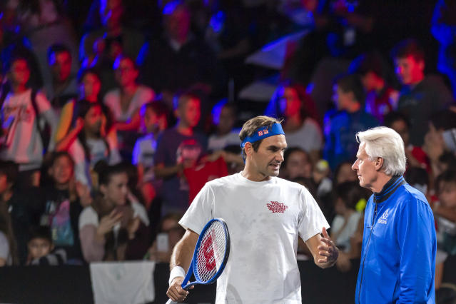 Team Europe's Roger Federer, left, speaks with the team captain, Bjoern Borg, right, during a training session for the Laver Cup in Geneva, Switzerland, Thursday, Sept. 19, 2019. The competition will pit a team of the best six European players against the top six from the rest of the world. The Laver Cup edition is scheduled for Sept. 20-22, 2019 at the Palexpo in Geneva. The Cup is named after the Australian tennis legend Rod Laver. (Martial Trezzini/Keystone via AP)