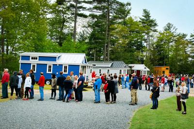 Crowds line up to get a glimpse of Petite Retreats' Tuxbury Tiny House Village. The tiny opening in South Hampton, NH celebrated Petite Retreats' first tiny house village in the Northeast.