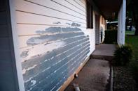 FILE PHOTO: Siding peels from the exterior of a home in the Pershing Park Fort Hood Family Housing subdivision, in Fort Hood, Texas, U.S May 16, 2019. REUTERS/Amanda Voisard
