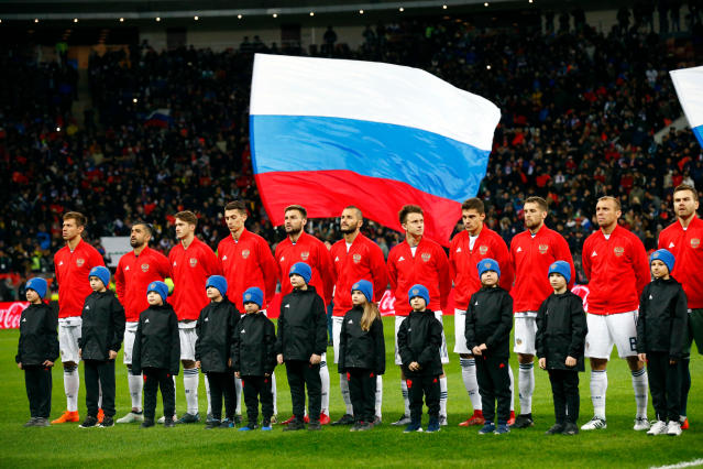 FILE - In this Friday, March 23, 2018 file photo, Russia players line up before an international friendly soccer match between Russia and Brazil at the Luzhniki stadium in Moscow. (AP Photo/Alexander Zemlianichenko, File)