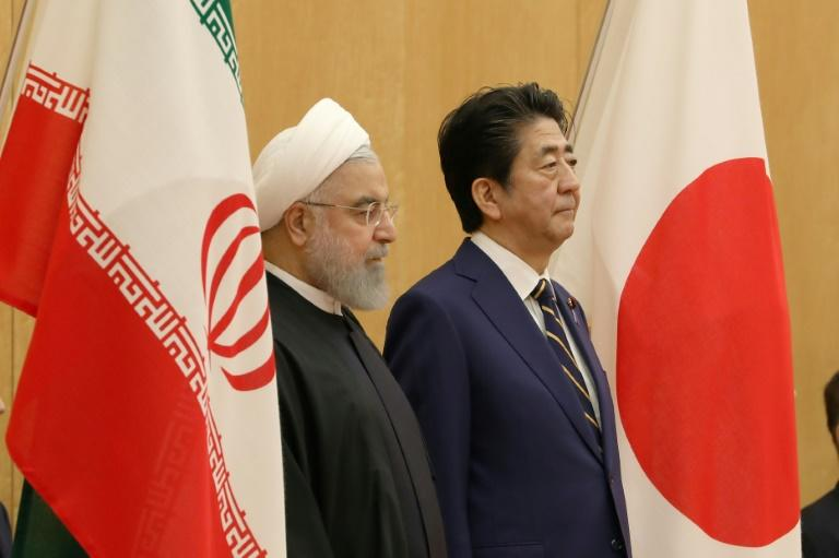 Japanese Prime Minister Shinzo Abe (R) with Iranian President Hassan Rouhani in Tokyo in December 2019. Tokyo and Tehran have longstanding ties and Abe is hoping to help ease regional tensions with his trip to Saudi Arabia, Oman and the UAE