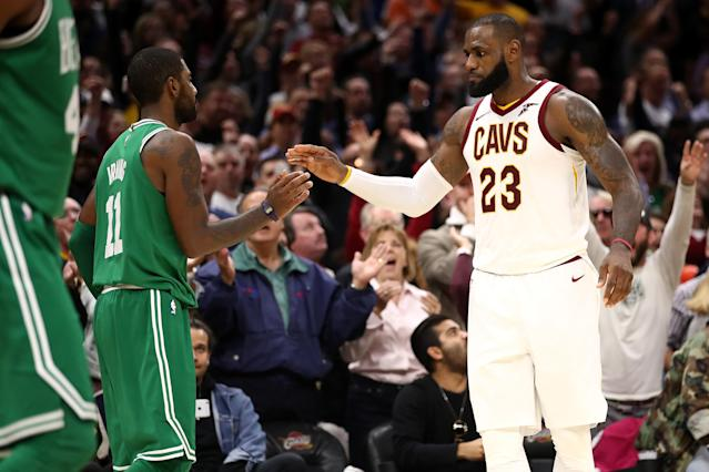 "<a class=""link rapid-noclick-resp"" href=""/nba/players/3704/"" data-ylk=""slk:LeBron James"">LeBron James</a> and <a class=""link rapid-noclick-resp"" href=""/nba/players/4840/"" data-ylk=""slk:Kyrie Irving"">Kyrie Irving</a> exchange pleasantries. (Getty)"