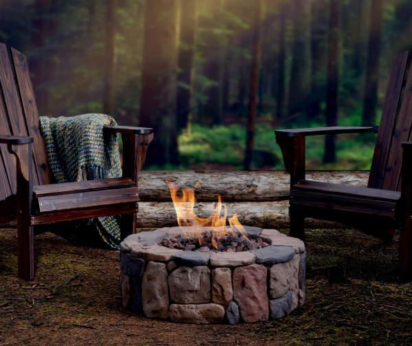 """The earthen look of this free-standing faux fire pit is so inviting. Can't you just picture gathering around it with your guests? This fire pit is powered by propane, surrounded by lava rocks, and comes with a protective cover. $446, Amazon. <a href=""""https://www.amazon.com/Bond-Manufacturing-66600-Petra-Fire/dp/B00J0K14KG"""" rel=""""nofollow noopener"""" target=""""_blank"""" data-ylk=""""slk:Get it now!"""" class=""""link rapid-noclick-resp"""">Get it now!</a>"""