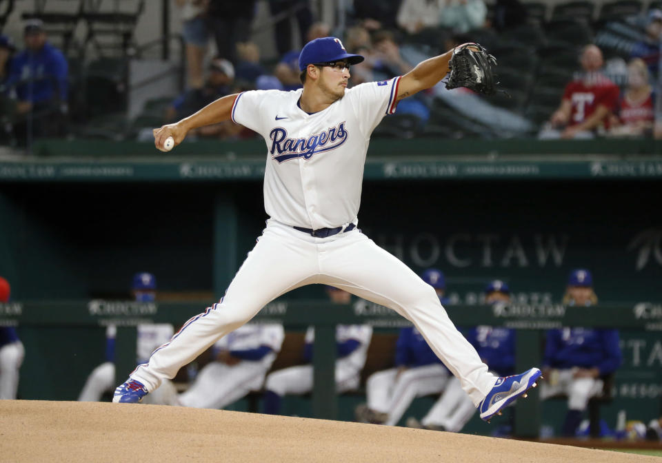 Texas Rangers starting pitcher Dane Dunning delivers to the plate against the Baltimore Orioles during the first inning of a baseball game in Arlington, Texas, Saturday, April 17, 2021. (AP Photo/Ray Carlin)