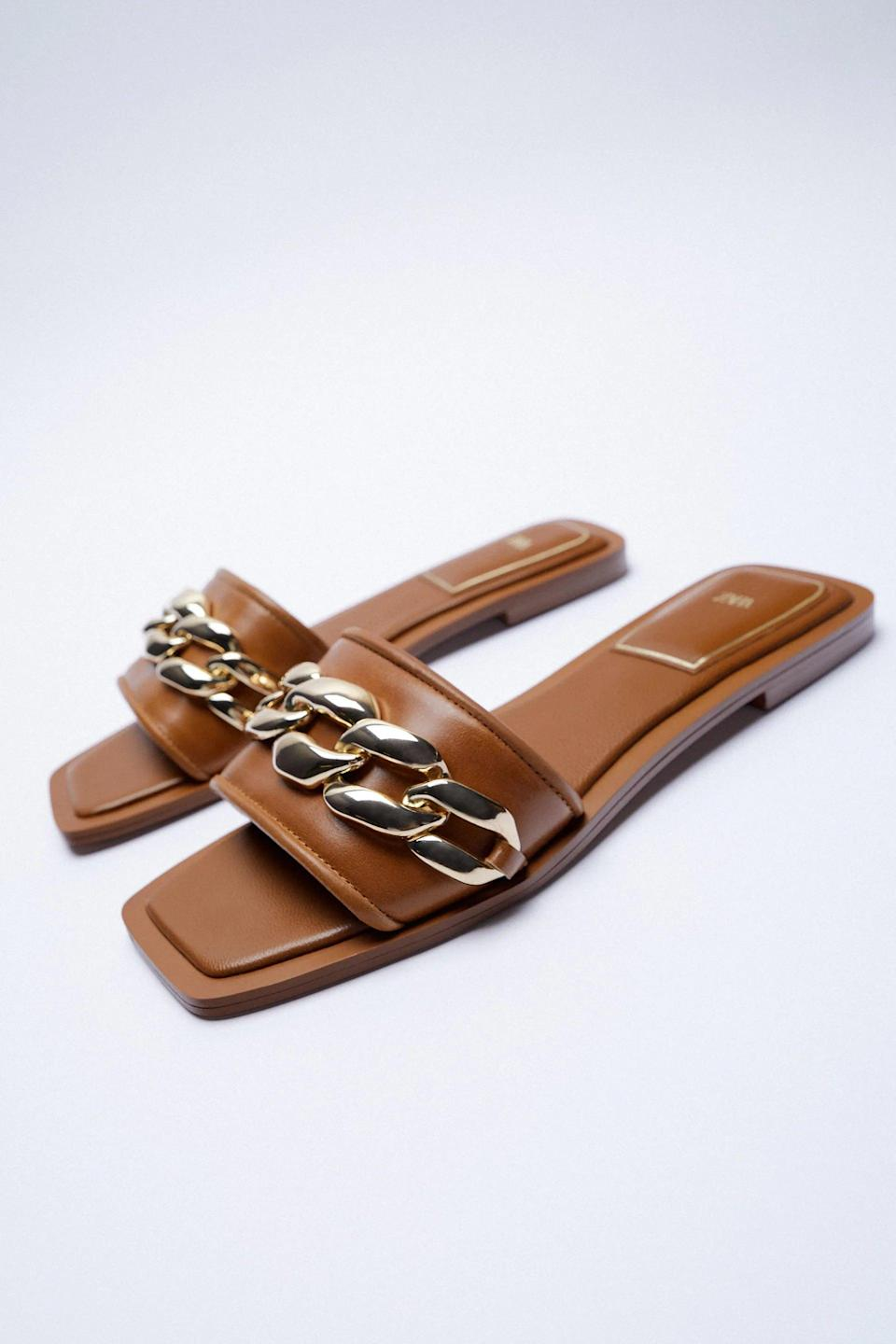 <p>If you want a classic, go-with-everything sandal, these <span>Zara Flat Leather Sandals With Chain</span> ($60) are it.</p>