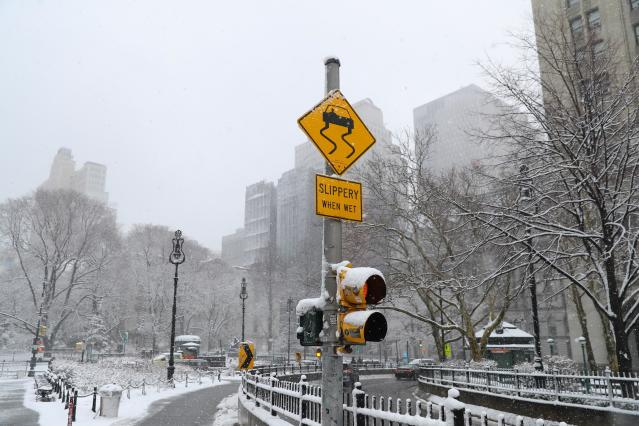 <p>A traffic sign gives fair warning just off the Brooklyn Bridge entering Manhattan as a winter storm moved into the area on Wednesday, March 21, 2018. (Photo: Gordon Donovan/Yahoo News) </p>