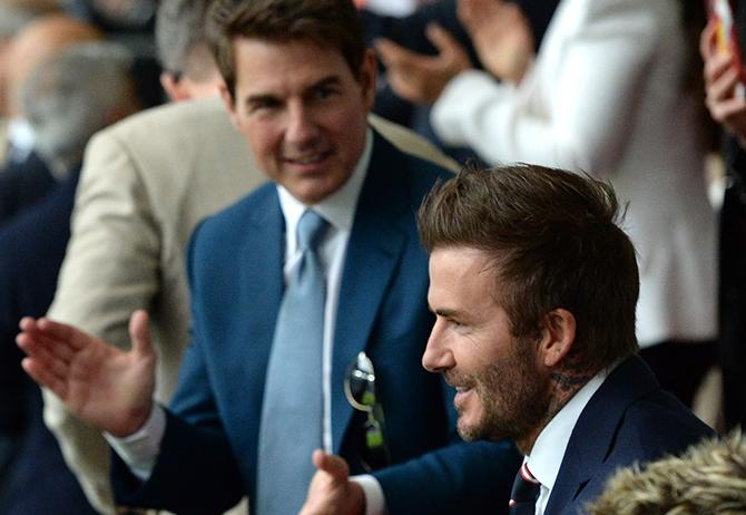 LONDON, ENGLAND - JULY 11: Former England international David Beckham and actor Tom Cruise applaud prior to during the UEFA Euro 2020 Championship Final between Italy and England at Wembley Stadium on July 11, 2021 in London, England. (Photo by Eamonn McCormack - UEFA/UEFA via Getty Images)