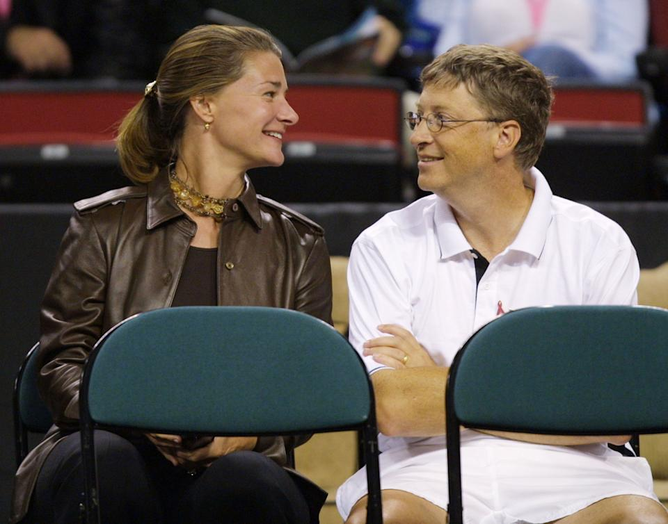 395479 07: Microsoft founder Bill Gates and his wife Melissa attend the Schick XTreme III Tennis Challenge October 7, 2001 at the Key Arena in Seattle, WA. (Photo by Jeff Vinnick/Allsport/Getty Images)