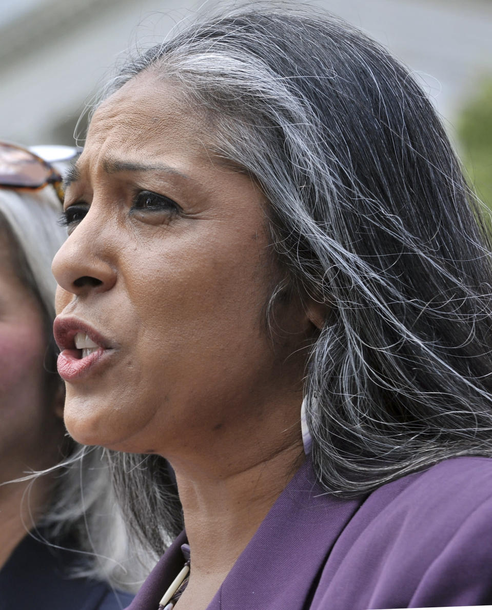 """FILE - In this June 8, 2010, file photo, Cheryl Andrews-Maltais speaks during a rally at the Statehouse in Boston. When Sen. John Barrasso, R-Wyo., snapped at Deb Haaland during her confirmation hearing, many in Indian Country were incensed. """"If it was any other person, they would not be subjected to being held accountable for their ethnicity,"""" said Andrews-Maltais, chairwoman of the Wampanoag Tribe of Gay Head Aquinnah in Massachusetts. (AP Photo/Josh Reynolds, File)"""