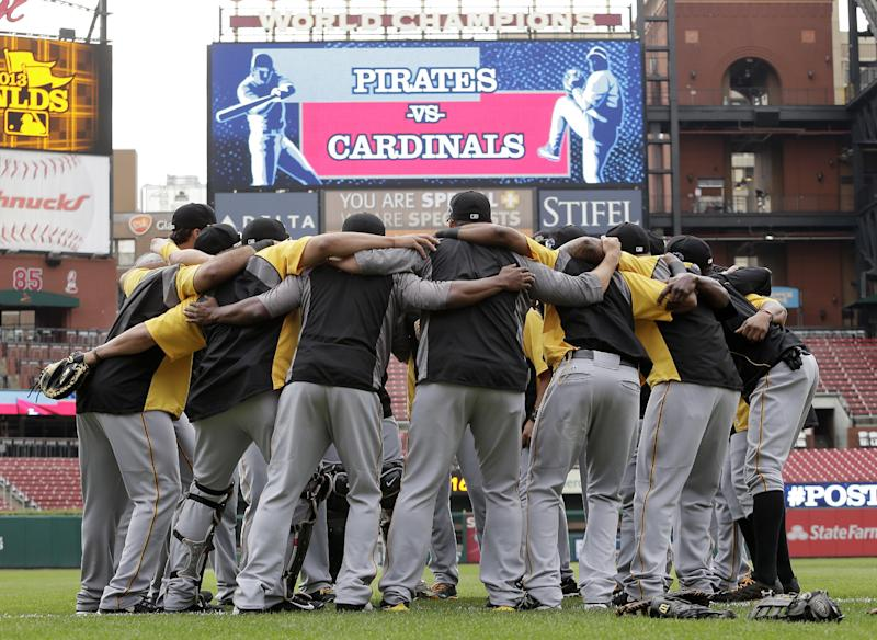 Pittsburgh Pirates players huddle together during a workout at Busch Stadium, Wednesday, Oct. 2, 2013, in St. Louis. Game 1 of the National League Division Series baseball playoff between the Pirates and the St. Louis Cardinals is scheduled for Thursday. (AP Photo/Charlie Riedel)