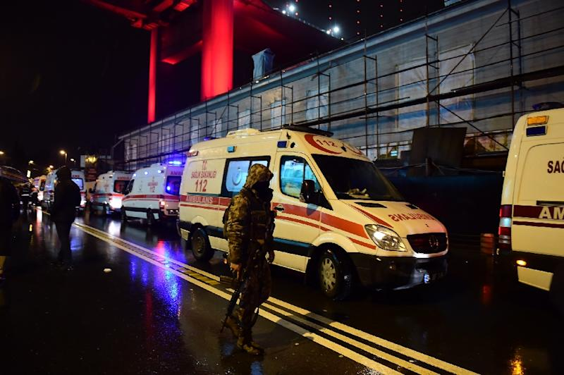 Turkish special force police officers and ambulances are seen at the site of an armed attack at the Reina nightclub in Istanbul on January 1, 2017