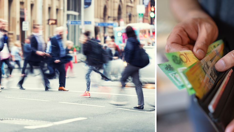 People cross a road in the Sydney CBD at rush hour. A man removes money from a wallet.