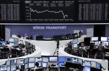 Traders are pictured at their desks in front of the DAX board at the Frankfurt stock exchange June 2, 2014. REUTERS/Remote/Stringer