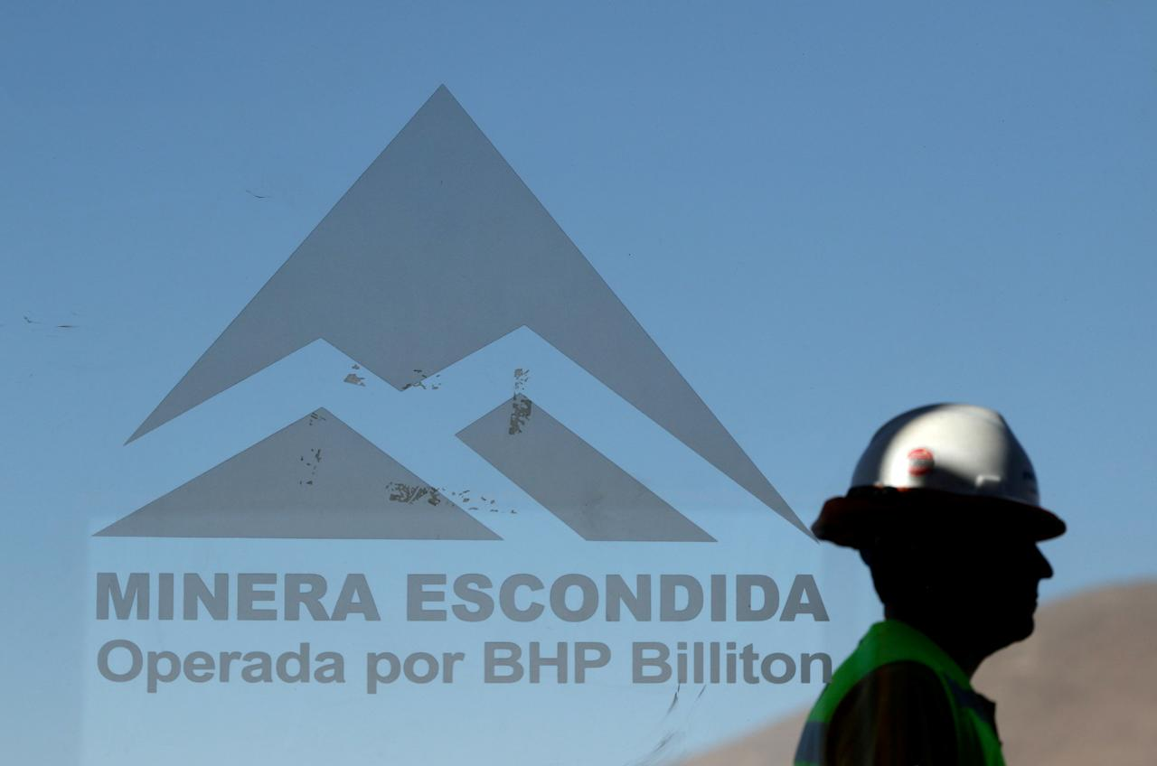 FILE PHOTO -  A worker from BHP Billiton's Escondida, the world's biggest copper mine, is seen outside the company gates during a strike, in Antofagasta, Chile February 10, 2017. REUTERS/Juan Ricardo/File Photo                GLOBAL BUSINESS WEEK AHEAD   SEARCH GLOBAL BUSINESS 20 FEB FOR ALL IMAGES