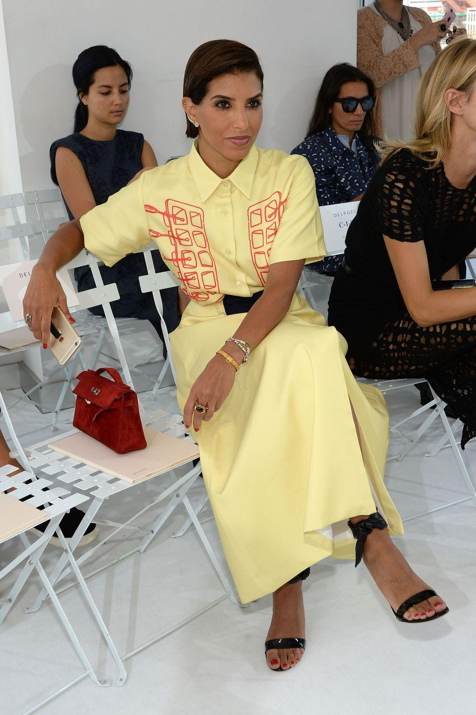 <p>She's a favorite of street style photographers for her daring looks. Here, she is pictured ere at the Delpozo Spring 2016 show in a striking yellow shirtdress. </p>