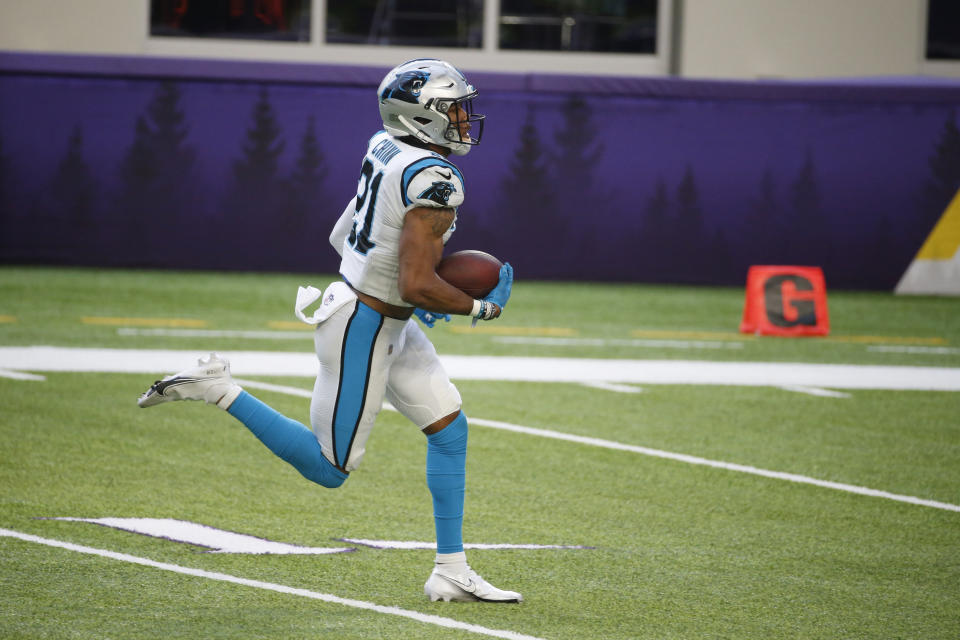 Carolina Panthers safety Jeremy Chinn runs with the ball 28 yards for a touchdown after recovering a fumble.