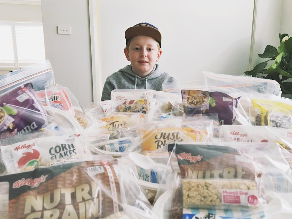 Photo shows Jackson Downes at a table with $63.80 worth of packed breakfasts.