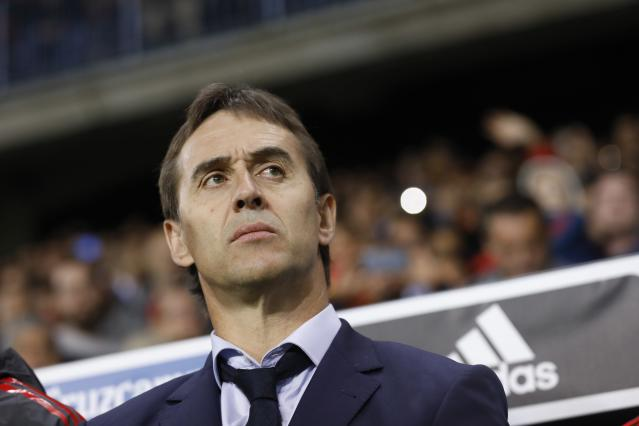 FILE – In this Saturday, Nov. 11, 2017 filer, Spain coach Julen Lopetegui stands by the bench during the international friendly soccer match between Spain and Costa Rica in Malaga, Spain. (AP Photo/Miguel Morenatti, File)