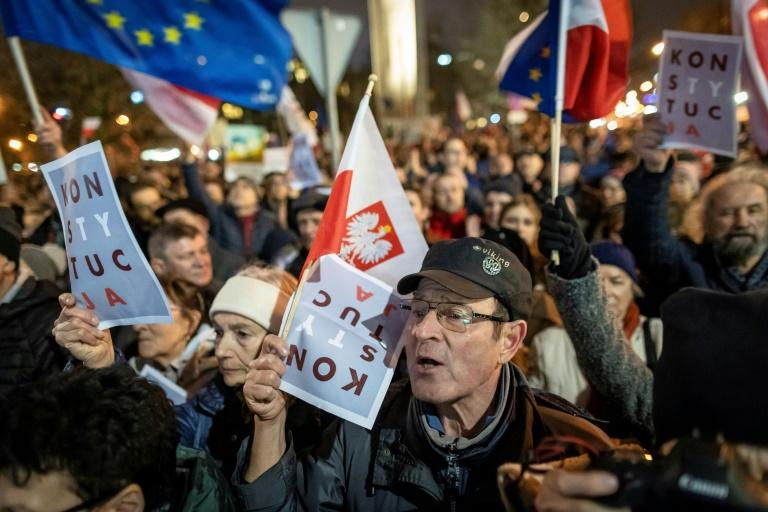 The rallies erupted a day after Poland's top court warned the reform plans would risk EU membership if they were enacted (AFP Photo/Wojtek RADWANSKI)